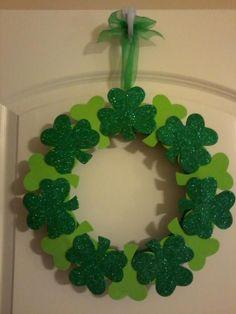 St. Pat's wreath... foam shamrocks (bought in 12 packs from Dollar Tree) glued around a foam ring.