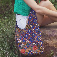 """These unique bags are sewn by rescued girls from """"lungis,"""" a garment worn by village Nepalese women. Your purchase of this lovingly handmade bag benefits young women at risk and those victimized by trafficking in Nepal by providing them a fair wage and hope for a new life. Fair Trade."""