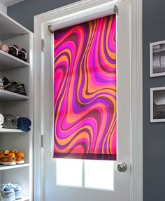 Spice up a mudroom with a bold Roller Shade. Shown in material Wave, color Storm.   The Shade Store
