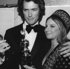 Here's Clint Eastwood and Barbra Streisand at the 1971 Golden Globe Awards holding their Globe/Henrietta Awards for the most popular film actor and actress that year. Both Clint and Barbra have a bevy of Golden Globe awards in their award stashes.