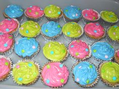 hot pink, blue, and lime green oreo cupcakes with creamcheese icing