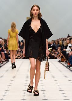 Black knitted stretch-cotton cashmere storm shield coat over a black silk satin dress with The Belt Bag in Oblong featuring suede and House check. Discover the collection at Burberry.com