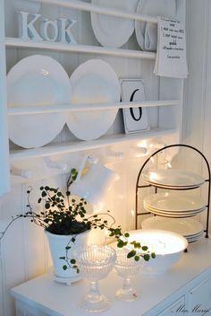 narrow shelves with plate rails, plus a prettily lit vignette below Wall Shelf Rack, Wall Shelves, Shelving, Narrow Shelves, Plate Racks, White Dishes, Home Decor Kitchen, Home Projects, Decorative Plates