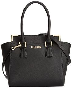 Crisp colorblocking adds a modern element to this classic crossbody bag Calvin Klein. Fashioned in luxe Saffiano leather with signature detailing, slender rolled handles offer a refined finish. Tote Backpack, Messenger Bag, Calvin Klein Handbags, Cute Purses, Shopper, Black Purses, Calvin Klein Black, Kelly Bag, Cross Body Handbags