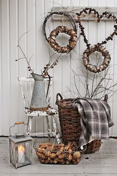 A grouping of rustic wreaths on hooks... lovely