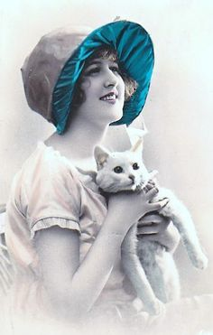 vintage tinted photo of a woman and white cat