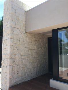 South Australian Limestone cladding in a mosaic pattern.