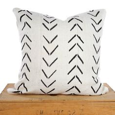 18 Inch Square White African Mud Cloth Pillow Cover This pillow is handmade with authentic hand dyed African Mud Cloth. The back of the pillow is natural colored linen with invisible zipper closure. Due to the handmade and vintage nature of these fabrics, it is recommended to spot clean
