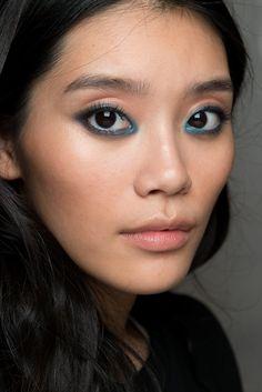 "Blue Eyeshadow, ""light-handed version"" Elie Saab. A model poses backstage before the Elie Saab Spring/Summer 2015 show."