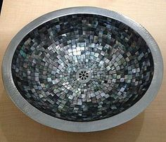 Mother of pearl, Midnight interior with 18 gauge in nickel finish exterior by Linkasink. Linkasink offers an assortment of sinks in a wide range of materials, styles and colors that will complement any contemporary kitchen or bath design. From history inspired sinks, to modern stainless steel, tile mosaics, creativity abounds. Come take a look for yourself we have many displayed in our showroom.