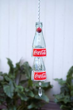 coca cola wind chime by BeeholdersEye on Etsy Coke Bottle Crafts, Wine Bottle Art, Glass Bottle, Garrafa Coca Cola, Coca Cola Decor, Coca Cola Bottles, Diy Wind Chimes, Bottle Cutting, Bottles And Jars