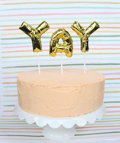 25 Stylish Adult Birthday Party Ideas - 11. Instead of boring candles in your birthday cake, use mini number or letter balloons on sticks.