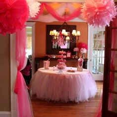 Absolutely adore the tutu table skirt.  Also love the tissue puff balls hanging from the ceiling...learned how to make those from the sweet bridesmaids at @Mary Costello's bridal shower =)