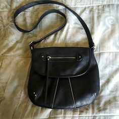 Black adjustable shoulder strap purse This cute purse is black with a polka dot lining insude.  Has one zipper outside and one zipper inside as well as two pockets Blue Bags Shoulder Bags