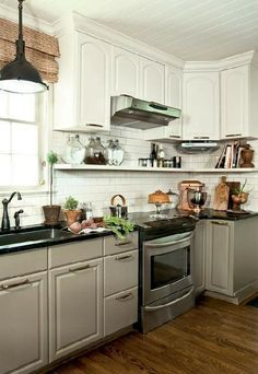 Simple kitchen makeover via Cottage Living. Bead board ceiling, open shelving.