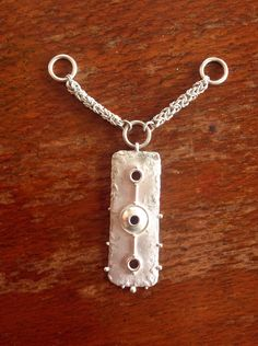Reticulated and fabricated silver pendant under construction. 'Byzantine' pattern chain adds a bit of body to the work. Based on the Battersea shield in the British Museum. By Gecko Skin Jewellery.