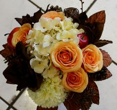 14.Autumn bride's posy of artificial roses,hydrangea,cones,fruits, amaryllis and brown foliages. Finished with hessian and wire.