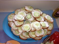 These are always a hit!! You need French bread sliced, 2 packages cream cheese, 1 package of ranch dressing, 2 cucumbers and dill. Mix the ranch and cream cheese together. Peel and cut the cucumber. Spread the cream cheese mix on the bread, place a cucumber on top and sprinkle with dill!!