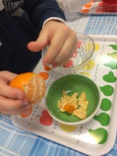 Sbucciare un mandarino
