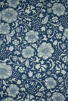 Dark Blue Floral Wallpaper. Original vintage floral wallpaper with a dark blue background and white flowers.