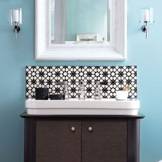 Tile the wall above your bath vanity with graphic ceramic squares. Adhere the new backsplash with mortar, grout the joints, and squeeze a bead of caulk where the tiles meet the countertop. Similar to shown: 4-by-4-inch Moroccan Talavera tile, about $1 each; finecraftsimports.com