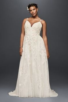 """Appliqued with pearl-centered blush flowers, this scalloped-bodice gown has an irresistibly ethereal feel. The tulle skirt is softly voluminous, and the double-strapped, low back lends a delicate feel.   Melissa Sweet, exclusively at David's Bridal  Plus size wedding dress, with 4"""" extra length  Polyester  Chapel train  Back zipper; fully lined  Dry clean  Imported  Also available in regular,petite, and extra length"""