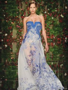 Semi-transparent Gown: Embroidered with royal blue floral arrangements, this flowing, semi-transparent gown is a graceful display of divine beauty that is sure to floor potential suitors. Strapless Dress Formal, Formal Dresses, White Fashion, Spring Summer Fashion, Floral Arrangements, Royal Blue, Abed Mahfouz, Blue And White, Gowns