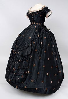Silk brocade ball gown with lace and ribbon trim, 1865-1875.