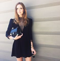 Chiara Ferragni of The Blonde Salad wearing a black dress with a plunging neckline and a lace high collar