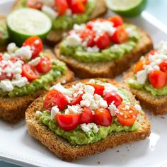 Greek avocado toast with cherry tomatoes   3 ripe avocados, peeled, pitted and diced Juice from 1 lime 1 clove garlic, minced Salt and pepper to taste 6 slices bread, toasted 1 cup fresh cherry tomatoes, halved 1/2 cup crumbled feta cheese Instructions