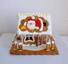 GINGERBREAD HOUSE~SANTA ON ROOF