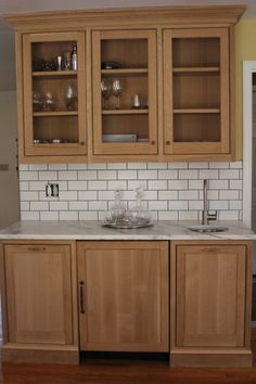 Our perimeter and fridge/oven/pantry and wet bar are all quarter sawn oak. The island is paint grade maple. I am finishing the oak with an a...