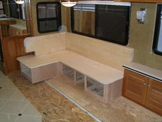 custom bench for dining with storage - very cool.  sort of what ours looked like, but we put in full twin size for sleeping purposes.  Gave kids lots of room to spread out when driving