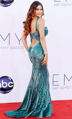 Sofia Vergara, who's nominated in the Outstanding Supporting Actress in a Comedy Series category for her portrayal of Gloria on Modern Family, was a total knockout (shocker!) in a teal hand-beaded Zuhair Murad mermaid-esque gown. Not one to shy away from flaunting her curves, the look featured a reverse halter neckline and open back. Vergara accessorized with over 175 carats of Neil Lane Diamond Hollywood Jewels.