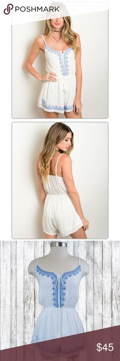 White and Blue EmbroideredCrinkle Romper This fully lined romper features adjustable spaghetti straps, elastic gathered waist, embroidered details throughout, and pom-Pom details at the leg openings. Dresses Mini