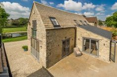 A stunning barn conversion on a generous plot with large pond to front and lawn to rear. The conversion works have been carried out to the most exacting standards using the finest materials available skillfully blending a cutting edge look whilst retaining bundles of character.