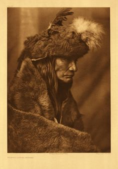 Pinokiminush is one of the few Piegan of advanced years and retentive memory. He was born about 1835 on Jusdith river in what is now northern Montana, and was found to be a valuable informant on many topics. The buffalo-skin cap is a part of his war costume, and was made and worn at the command of a spirit in a vision. The first fasting of Tearing Lodge for the sake of experiencing a vision is narrated by him in Volume VI, pages 79-81.