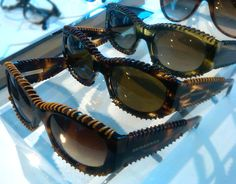 Burberry sunglasses featuring leather whipstitch detailing.