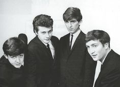 Scan - Publicity shot of The Beatles (still with Pete Best) in their new suits, 1962
