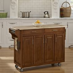 Home Styles 48.75-in L x 17.75-in W x 34.75-in H Cottage Oak Kitchen Island Casters
