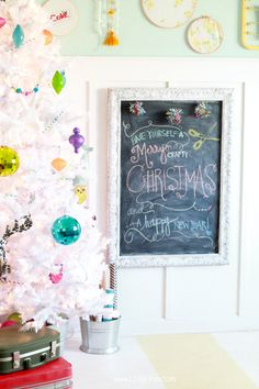 The colorful white Christmas tree perfectly match the vibrant decor in Kelli and Kristi's craft room. Via @LollyJaneBlog