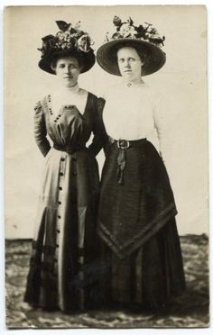Wow! Such fashion! Love the hats and tiny waists!