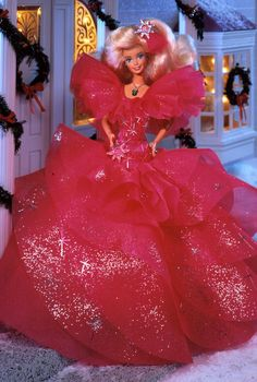 Special Edition   Release Date: 1/1/1990    Dressed in pink, Barbie® doll's layered fuchsia gown glitters with sparkling silvery accents. Poufed sleeves and accompanying star ornament add special touches to this lovely vision of holiday bliss