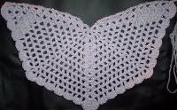 Here's a decorative and wearable shawl that can be created by following this easy crochet pattern. This angel wings shawl pattern is a wonderful craft, perfect for the holiday season or just when it starts to get cold outside.