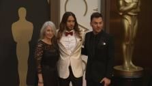 Jared Leto, brother Shannon and their mother walk the red carpet at the 2014 Oscars in Hollywood, California on Sunday, March 2, 2014. - Provided courtesy of OTRC