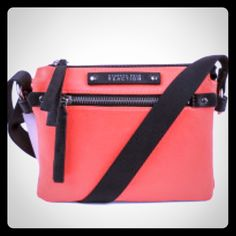 NWT Kenneth Cole Reaction Orange Crossbody Purse Adorable crossbody purse new and never used. Has 3 compartments inside with built in Credit Card slots and phone pouch. Exterior has front zipper pocket and back has an open slit pocket. Adjustable crossbody strap can be shortened to make a shoulder purse. Perfect for Spring! Kenneth Cole Reaction Bags Crossbody Bags