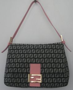 Fendi zucca print 'Borsa Large Mamma' bag. Black & grey FF print with flap over detail. Features detachable pink leather strap. Has pink leather tab with gold tone logo magnetic snap closure. Fabric lining with 1 zip pocket.