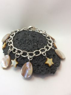 A personal favourite from my Etsy shop https://www.etsy.com/uk/listing/451622180/gemstone-charm-bracelet