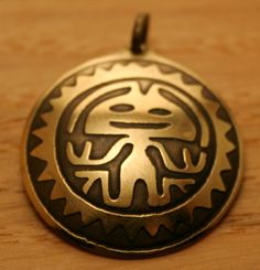Aztec chieftain.  Brass pendant with picture of man etched from ancient pictures of aztecs. Patinated.  Diameter - 3 cm or 1.2 inch            Welcome