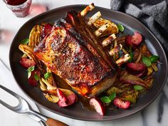 A simple brine in smoky lapsang souchong tea takes this roasted rack of pork loin over jammy plums and tender fennel to flavorful new heights. Get the recipe at Food & Wine. Pork Recipes, Wine Recipes, Brine Pork Loin, Rack Of Pork, Roasted Fennel, Easter Recipes, Easter Desserts, Healthy Dinner Recipes, Spring
